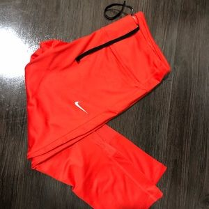 selling these red/orange cropped Nike leggings